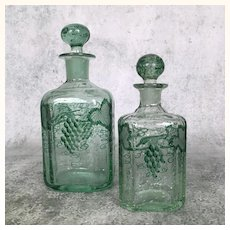 Pair of19th Century blown green glass decanters