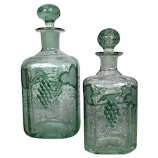 Pair of 19th Century blown green glass decanters