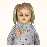 Antique German  papier mache blonde girl with blue eyes and pretty dress