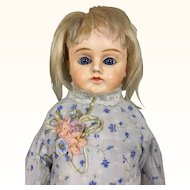 Antique papier mache blonde girl with blue eyes and pretty dress