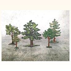 Five miniature cast iron trees