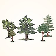 Five miniature cast metal trees