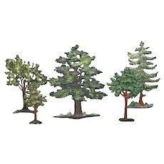 Five miniature cast iron trees