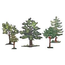Five miniature cast metal trees
