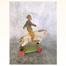 Vintage painted wood bucking bronco pull toy
