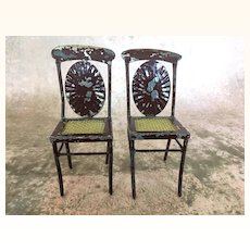Vintage pair of painted tin dollhouse chairs