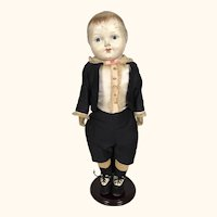 Composition boy doll in formal clothing