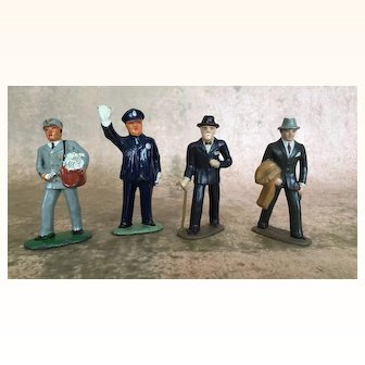 Group of four vintage Barclays cast metal men