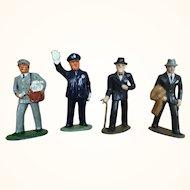 Group of four vintage Barclays cast metal men