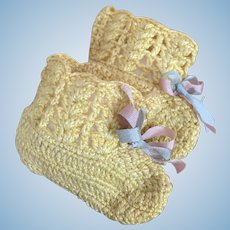 Small sized yellow crocheted doll booties