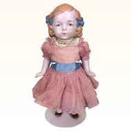 Pink tinted all bisque 7 inch blonde girl in pink dress