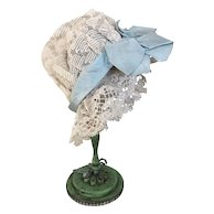 Antique lace doll's morning cap with pale blue bow
