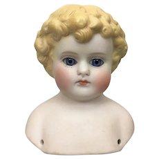 ABG blonde tinted bisque head glass eyes, model 890