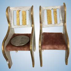 Pair of enameled and gilt wooden dollhouse armchairs
