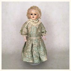 Cabinet size papier mache girl with beautiful face and crier strings