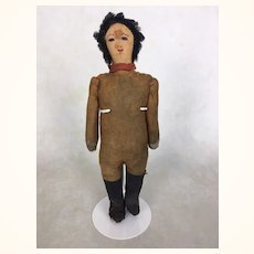 Early primitive leather and cloth doll