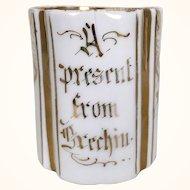Unusual antique child sized gilt porcelain cup