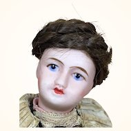 Miniature bisque head France Unis doll in original clothing