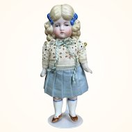 Blonde all bisque German girl with bows and freckles