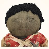 Vintage black cloth doll stockinette with red Dress
