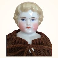 Antique Blonde China head doll with Highland Mary Hairstyle
