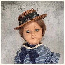 Unusual girl doll with metal head and hands