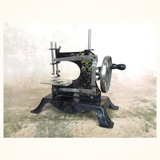 Antique miniature German sewing machine