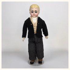 German bisque blonde man by Gebruder Kühnlenz with glass eyes and wonderful clothing