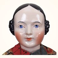 Large Pink-Tinted China Head Lady with Finely Sculpted face and Gorgeous Clothing