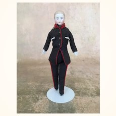 Antique dollhouse man in well fitting uniform