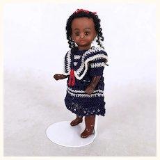 Rare miniature adorable black girl in crocheted dress