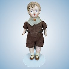 Antique small papier mache boy in factory original clothing