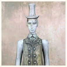 Vintage folk art sculpture man in top hat