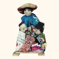 Vintage artist dolls depicting Chinese people