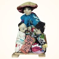 Vintage artist ethnic dolls depicting Chinese people
