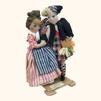Vintage artist folk art dolls depicting Scottish dancing couple