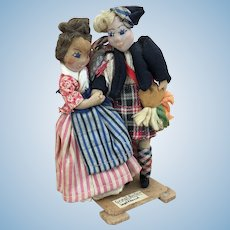 Vintage artist folk art dolls depicting Scottish dancing couple