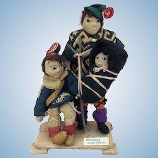 Vintage artist folk art dolls depicting Norwegian Lapland family