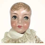 Papier mache boy doll with delicious hair