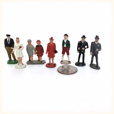 Vintage group of 8 miniature enamelled metal people