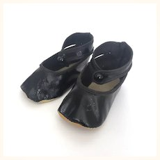 Vintage black oilcloth doll shoes with ankle straps