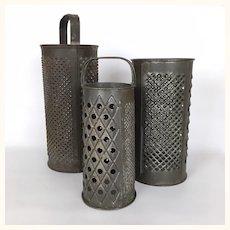 Antique set of three kitchen graters