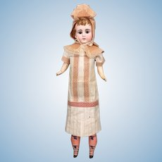 Unusual German Belton bisque head doll on elongated body in factory original  clothing