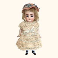 Antique German very pretty all bisque girl with blue socks and blue sleep eyes