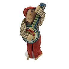 Vintage windup monkey playing banjo