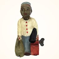 Occupied Japan Celluloid wind up toy porter with moving head