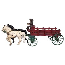 Kenton cast iron horse drawn stake wagon with driver and two horses