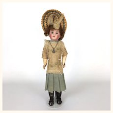 Mystery doll in original clothing and bonnet
