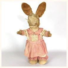 Vintage toy stuffed rabbit in original clothing
