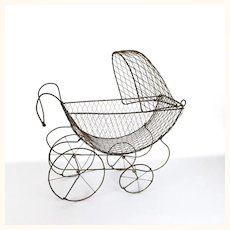 Antique wire doll carriage
